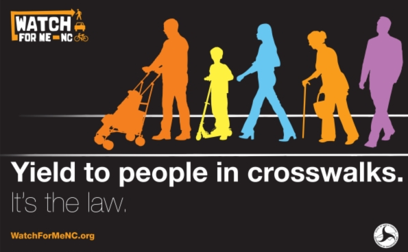 Poster with illustrations of pedestrians says Watch For Me, Yield To people in crosswalks, It's the law