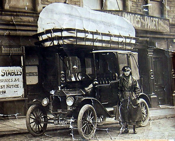 A 1920s cab with a large bag on top for coal gas fuel