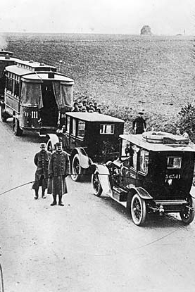 This historical photo shows taxicabs waiting to go to the Marne battlefront in World War I; links to the Taxi Library history and culture page