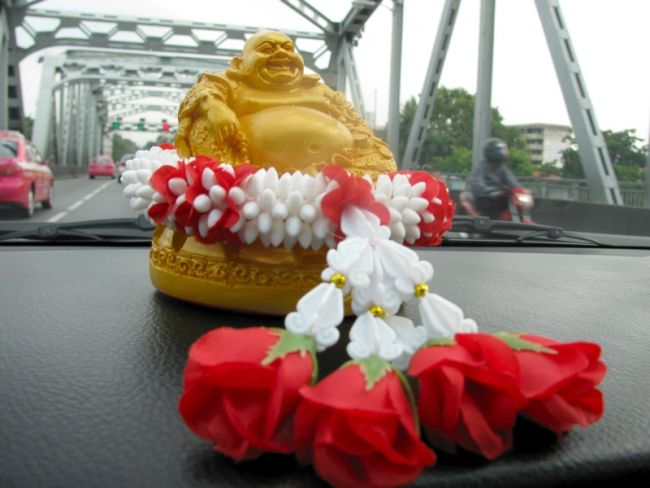 Small statue on the dashboard of a Bangkok taxi