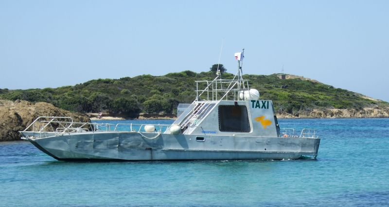 A big motor boat with the word TAXI painted on the side