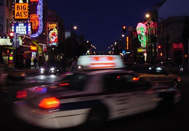 A cab streaks through the honky-tonk district of North Beach.
