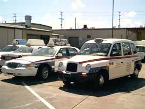 Ford and London cabs side by side