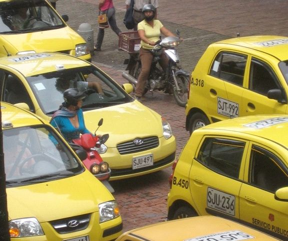 Photo of taxis and motorbikes in traffic
