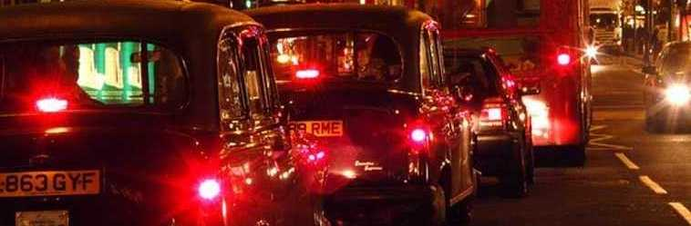 Nightime light reflections on London taxis - photo courtesy of FreeFoto.com