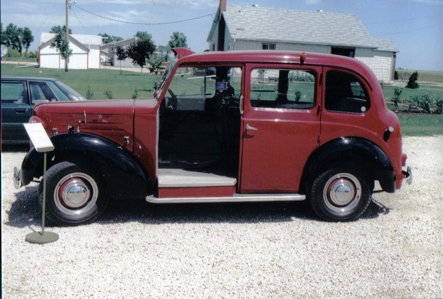 Maroon-colored vintage London taxi