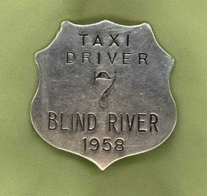 Photo of a taxi driver badge with the number seven