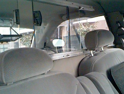 Clear polycarbonate window between the front and back seats