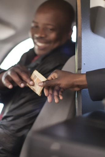 Photo of a customer handing a cash tip to an appreciative taxi driver; links to the Tipping section on the Culture page