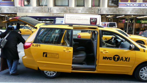 Photo of a NYC minivan taxi with a partition