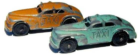 Two colorful antique toy taxicabs by Cliff Lundberg